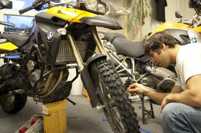 AltRider's Jeremy LeBreton removes the forks from the BMW F 800 GS to send to Ohlins USA