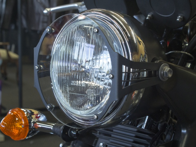 AltRider Clear Headlight Guard for the Triumph Scrambler - Black - Installed