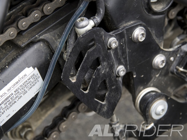 AltRider Rear Brake Master Cylinder Guard for the Husqvarna TR650 Terra and Strada - Black - Installed