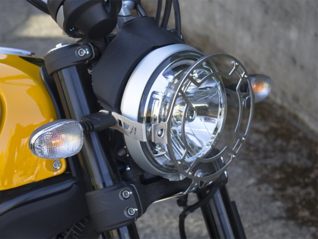 AltRider Clear Headlight Guard for the Ducati Scrambler - Silver - Installed