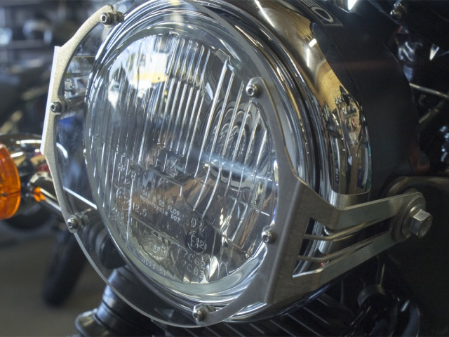 AltRider Clear Headlight Guard for the Triumph Scrambler - Silver - Installed